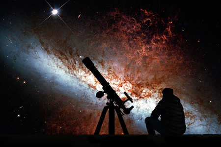 Man with telescope looking at the stars. Messier 82, Cigar Galaxy or M82 in the constellation Ursa Major Elements of this image are furnished by NASA.