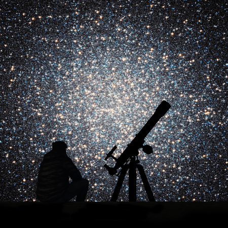 Man with telescope looking at the stars. Globular cluster Omega Centauri in constellation Centaurus Elements of this image are furnished by NASA. Stock Photo
