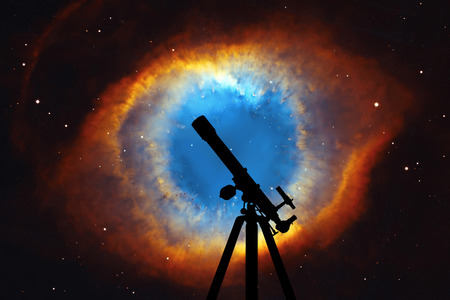 Space background with silhouette of telescope. The Helix Nebula or NGC 7293 in the constellation Aquarius.  Elements of this image are furnished by NASA.