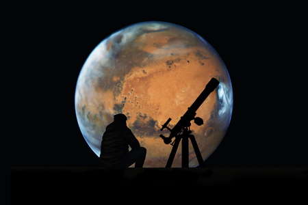 Man with telescope looking at the stars. Mars planet, isolated on black.
