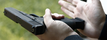 Loading Handgun. Reloading handgun.