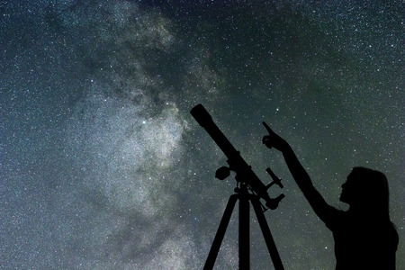 Girl looking at the stars. Telescope Milky Way Banco de Imagens