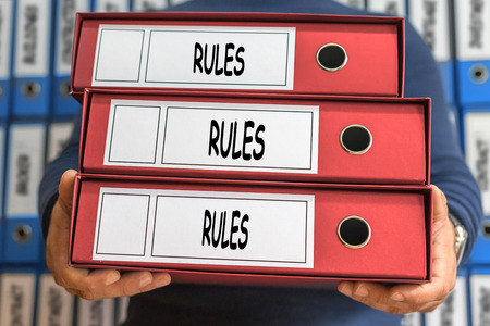 Rules, Rules, Rules concept words. Folder concept. Ring binders. Stockfoto