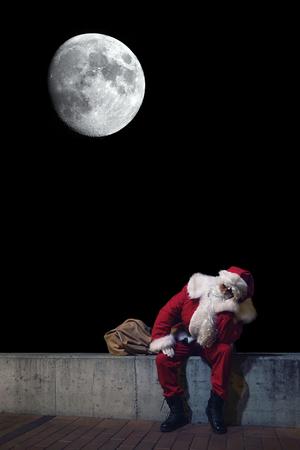 Santa Claus with sack. Magic Christmas Lights Stock Photo