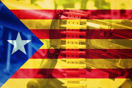 Catalonia Spain conflict machine gun with national flag of Catalonia