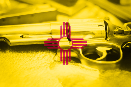 New Mexico flag (U.S. state) Gun Control USA. United States Gun Laws. Stock Photo