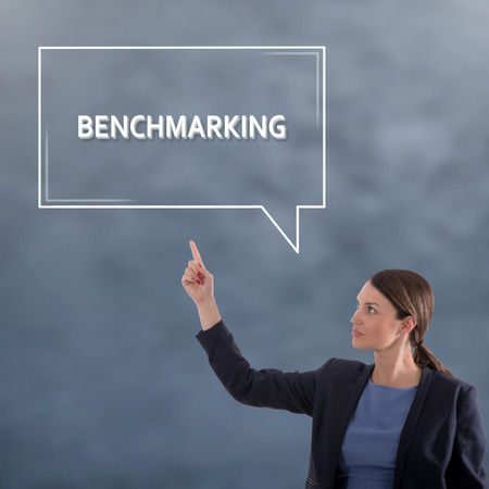 BENCHMARKING CONCEPT Business Concept. Business Woman Graphic Concept Stock Photo
