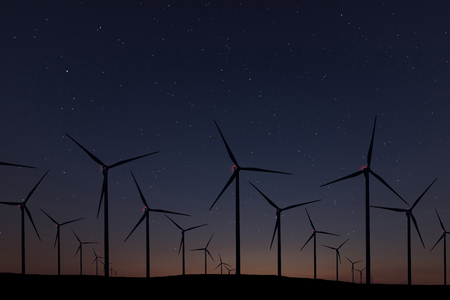 Night Sky Over Wind Farm. Energy and nature Night Sky.