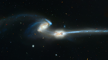 Colliding galaxies, Mice Galaxies, spiral galaxies in constellation Coma Berenices.   Retouched image.