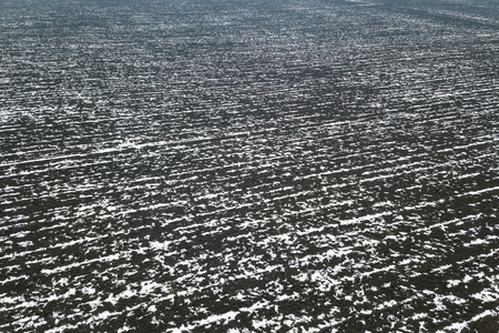 Top view of agricultural fields covered with snow.