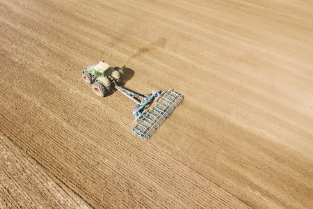 Aerial view Tractor preparing field, Agriculture tractor landscape
