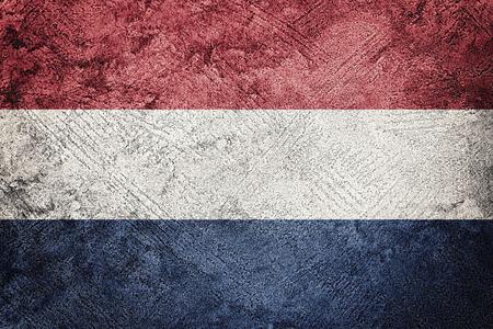 Grunge Nederland flag. Nederlands flag with grunge texture. Foto de archivo