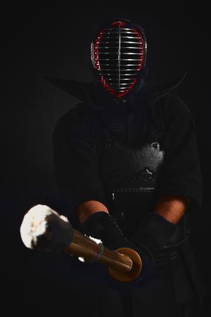 Kendo fighter with shinai (bamboo sword) Tradition kendo armor