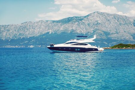 Modern Yacht, Luxury Yacht in Azure Sea Parked in Beautiful Blue Bay. Stock fotó