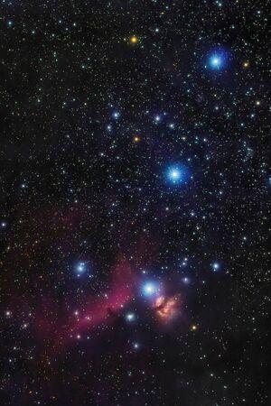 Orions belt in the winter sky, stars Alnitak, Alnilam, Mintaka, Horsehead Nebula, Orion Nebula Фото со стока