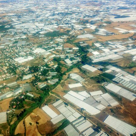 Aerial View of Many Greenhouses  on Farm Land  写真素材