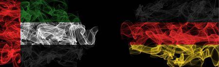 Flags of UAE and Germany on Black background, UAE vs Germany Smoke Flags Stock Photo