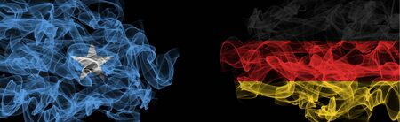 Flags of Somalia and Germany on Black background, Somalia vs Germany Smoke Flags