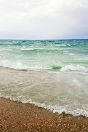Strong waves crash over the beach Beautiful seascape. Reklamní fotografie