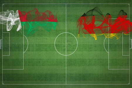 Madagascar vs Germany Soccer Match, national colors, national flags, soccer field, football game, Competition concept, Copy space