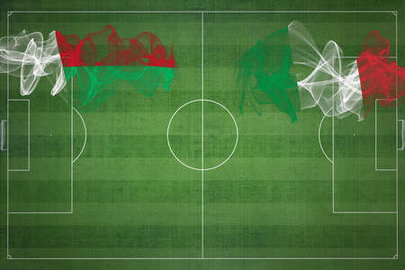 Madagascar vs Italy Soccer Match, national colors, national flags, soccer field, football game, Competition concept, Copy space Фото со стока
