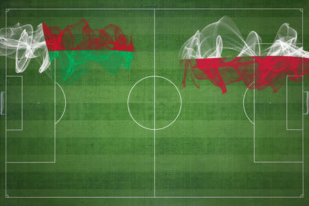 Madagascar vs Poland Soccer Match, national colors, national flags, soccer field, football game, Competition concept, Copy space Фото со стока