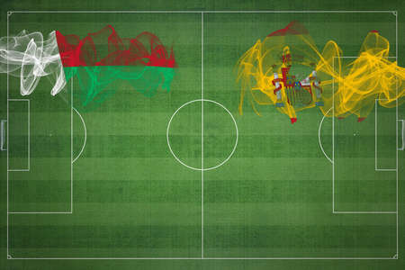 Madagascar vs Spain Soccer Match, national colors, national flags, soccer field, football game, Competition concept, Copy space