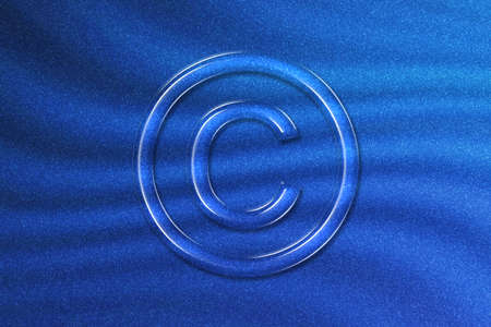 Copyright Symbol, C letter in circle, blue glitter background
