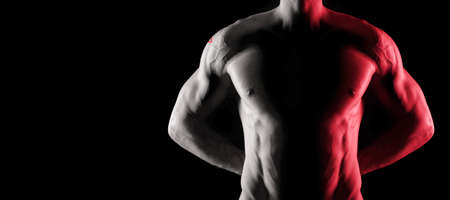 Malta flag on muscled male torso with abs, black background