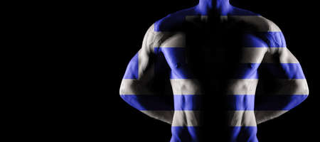 Greece flag on muscled male torso with abs, black background