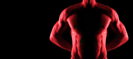 Morocco flag on muscled male torso with abs, black background Archivio Fotografico
