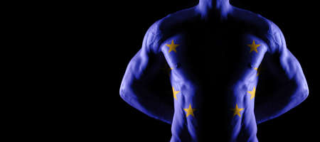 European Union flag on muscled male torso with abs, black background Archivio Fotografico