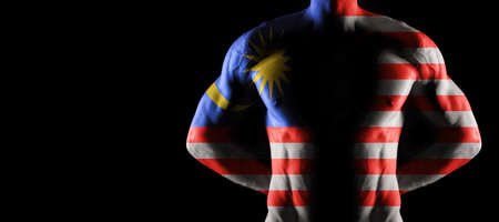 Malaysia flag on muscled male torso with abs, black background