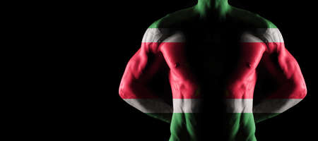 Suriname flag on muscled male torso with abs, black background