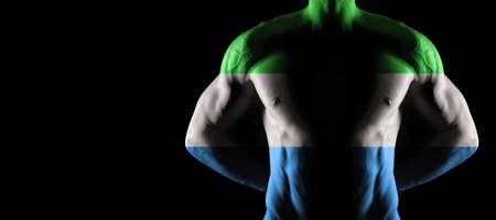 Sierra Leone flag on muscled male torso with abs, black background