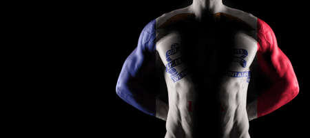 Iowa flag on muscled male torso with abs, Iowa bodybuilding concept, black background
