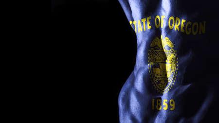 Oregon flag on abs muscles, Oregon bodybuilding concept, black background 版權商用圖片