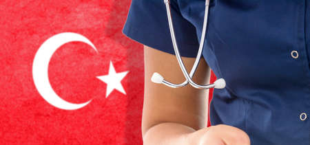 Turkey flag female doctor with stethoscope, national healthcare system