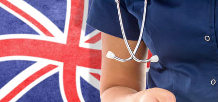United Kingdom flag female doctor with stethoscope, national healthcare system