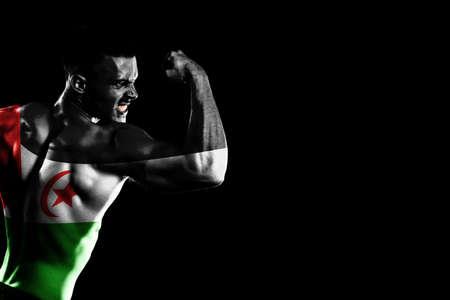Sahrawi Arab Democratic Republic flag on handsome young muscular man black background