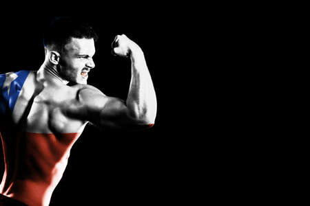 Chile flag on handsome young muscular man black background