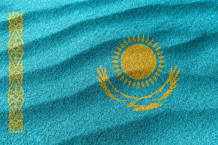 Kazakhstan sand flag, national flag sand background Foto de archivo