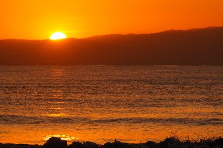 Dramatic coastal sunsets and waves