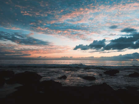 Pangandaran is one of West Java's best kept-secrets as far as international tourists are concerned. Pangandaran offers uniquely black and white sand, calm waved beaches and spectacular sun Reklamní fotografie