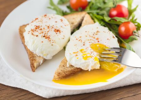 benedict: the poached eggs with toast and salad