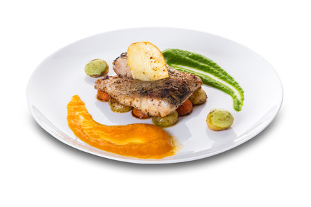 fried fish with vegetables on white isolated background