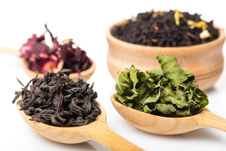 set of dry teas on white isolated background
