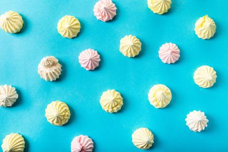 food background, dessert meringue on blue Stock Photo