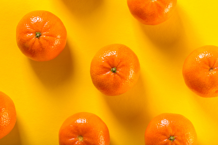 food background, tangerines on yellow