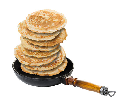 pancakes in a frying pan on white isolated background
